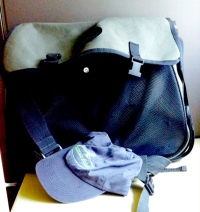 Famous Fishing cap ready to go in my holiday ART bag