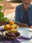 An artist working on purple and yellow