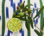Olives and a cut lime on a Casa Rosa cushion